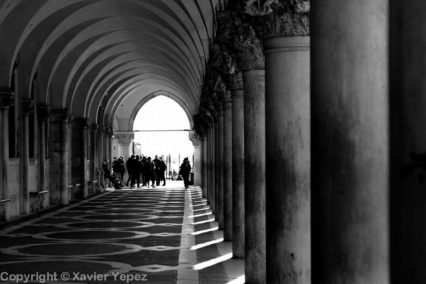 Black and white photo of the arcs on the right side of the Piazza San Marco in Venice, Italy