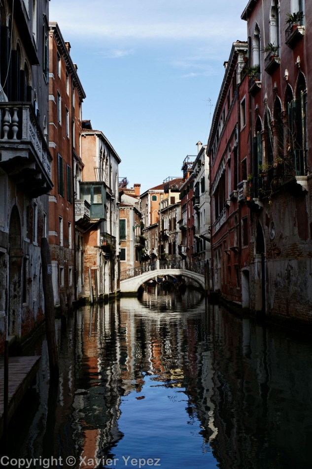 A view of a quiet canal surrounded by colorful houses, Venice, Italy