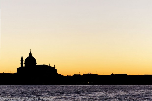 A silhouette of a church in a sunset, Venice, Italy